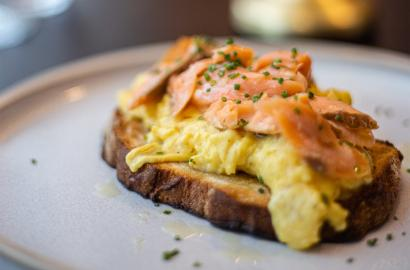 Scrambled eggs and salmon on a toast
